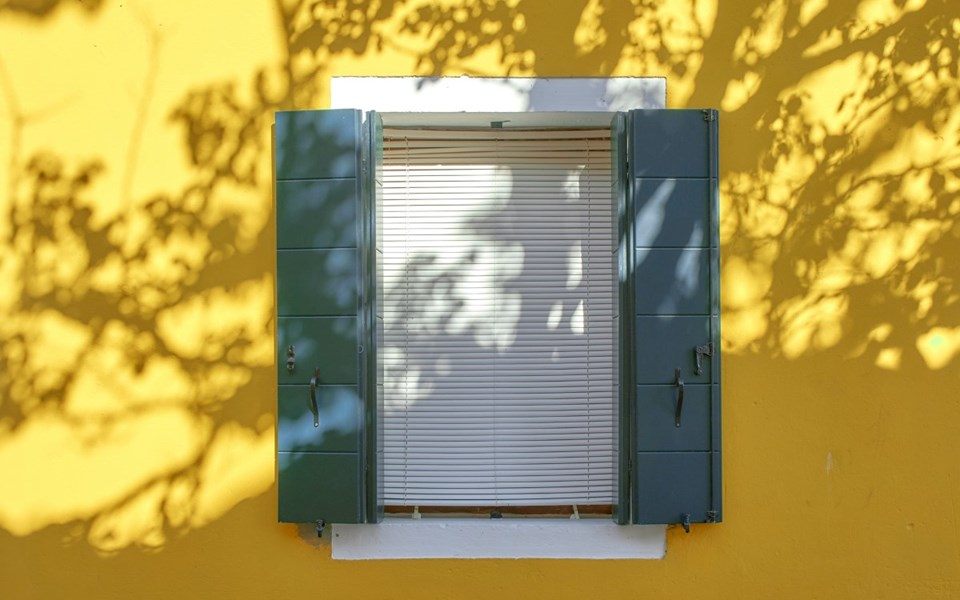 Close your house as much as possible when the sun is out. Close shutters, curtains and doors, and open them again for fresh air when it has cooled down.