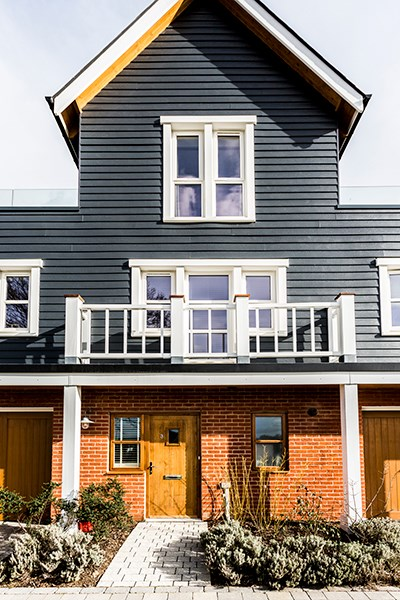 Black Cedral shiplap cladding with a wood effect finish